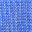 Macro view of a blue yoga mat — Stock Photo