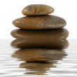 Stack of zen rocks with water reflection — Stock Photo