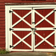 Old red bard doors - Stock Photo