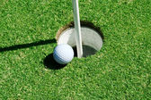 Golf Ball on green near hole — Stock Photo