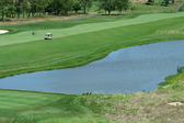 Golf course fairway with water hazzard — Stock Photo