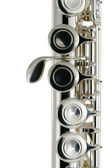 Isolated metal flute on white — Stock Photo