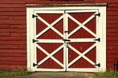 Old red bard doors — Stock Photo