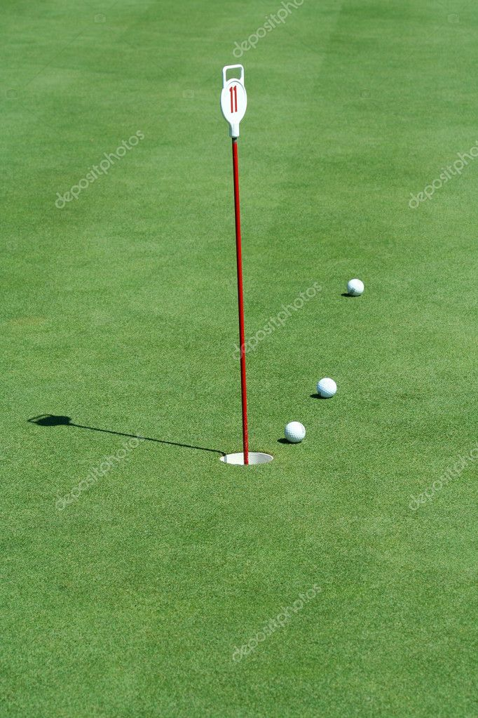 A Practice putting green with golf balls  Stock Photo #2040056