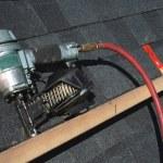 Pneumatic roofing nail gun — Stock Photo
