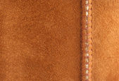 A Brown suede background with seam — Stock Photo