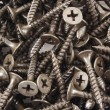 Black Screws background texture — Stock Photo