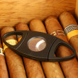 Cigars with cutter - Stock Photo