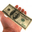 One hundred dollar bills in a hand — Stock Photo