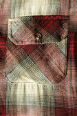 Red flannel shirt pocket — Stock Photo
