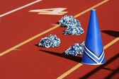 Cheerleader pom poms and megaphone — Stock Photo
