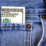 One hundred dollar bill in jeans pocket — Stock Photo