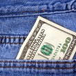 One hundred dollar bill in jeans pocket — Stock Photo
