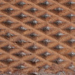 Close up of a diamond shaped metal rusty — Stock Photo