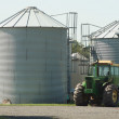 Farm Tractor and silos — Stock Photo