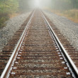 Foggy Railroad Tracks - Stockfoto