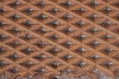 Close up of a diamond shaped metal rusty — Stock Photo