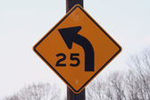 25 mph curve sign — Stock Photo