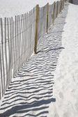Fence on a beach — Stock Photo