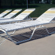 Stok fotoğraf: Reclining chairs at pool