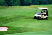 Golf cart on golf course — Stock Photo