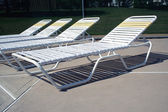Reclining chairs at the pool — Stok fotoğraf
