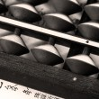 Old abacus and a paper — Stock Photo