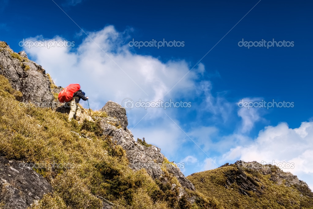 Mountain climbing of man back heavy red backpack walking. — Stock Photo #2007532