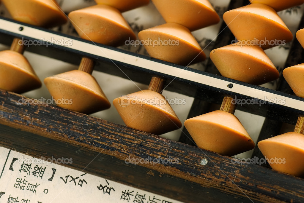 Traditional abacus lay on a paper write in Chinese words. — Stock Photo #2008183