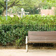 Foto de Stock  : Brown bench with nobody in park