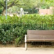 Brown bench with nobody in the park - Stock Photo
