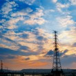 Sunset cityscape of power tower — Stock Photo