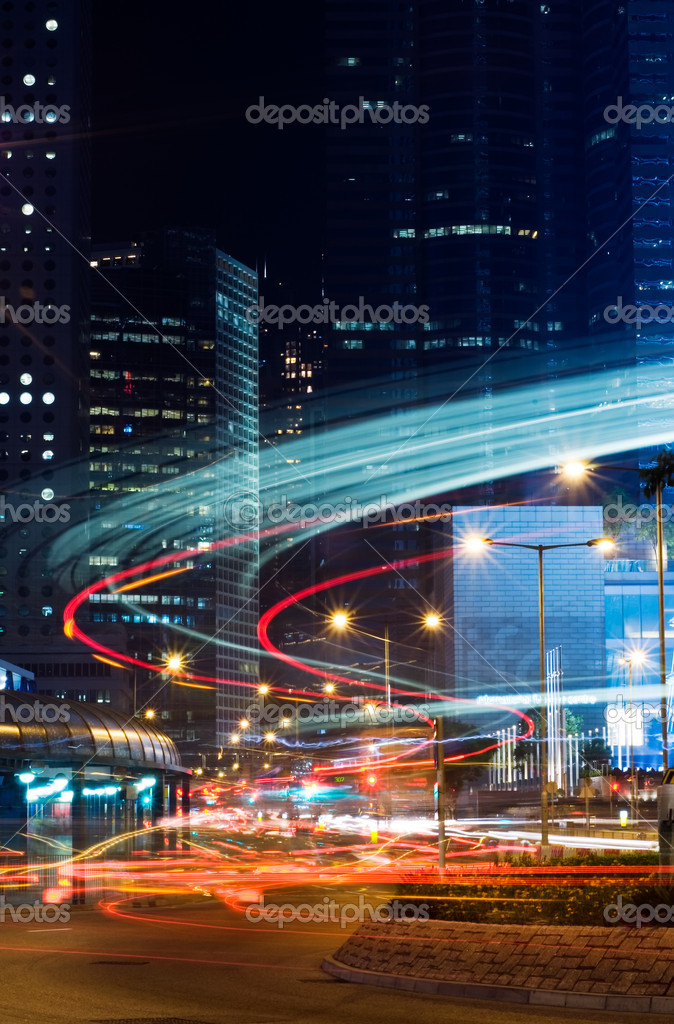 Beautiful night scenes of skyscraper with light and motion blurred of cars in Hong Kong. — Stock Photo #2019499