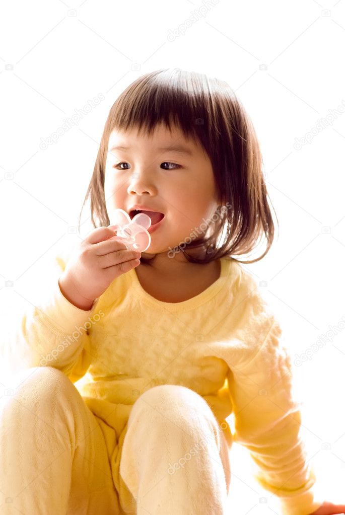 Lovely Asian baby sit and suck pacifier in the white background. — Stock Photo #2019832