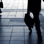 Businessman silhouette carry briefcase — Stock Photo