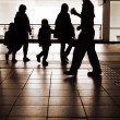 Family silhouette in station — Stock Photo