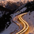 Car light in night on ice road — Stock fotografie