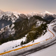 Mountain night with snow and ice on road — Stockfoto
