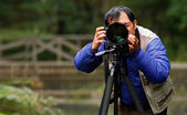 Asian photographer in outdoor — Stock Photo