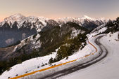 Mountain night with snow and ice on road — Stock Photo