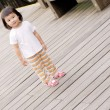 Children stand on the wood ground — Stock Photo