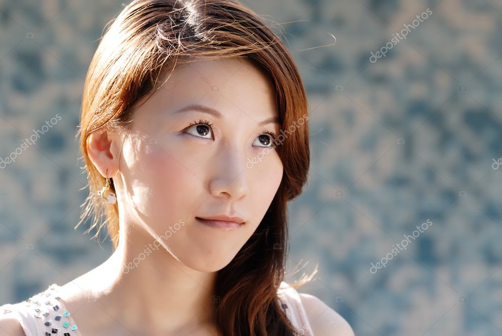 Here is a beautiful Asian lady in front of mosaic and think.  Stock Photo #2161695