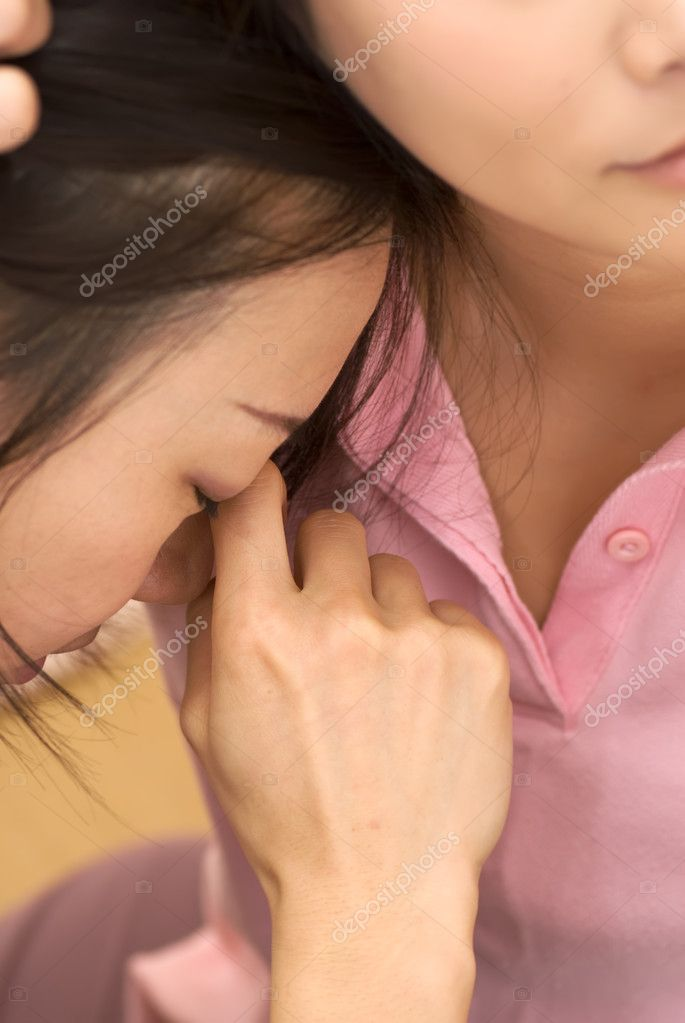 Sad woman of Asian leaning on shoulders of friend and wipe eyes. — Stock Photo #2615841
