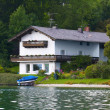House at the lake — Stok fotoğraf