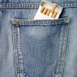 Cigarettes in a jeans pocket — Stock Photo