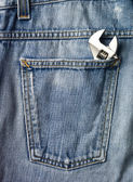 Screwdriver in a jeans pocket — Stock Photo