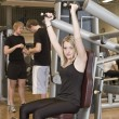 Stock Photo: Girl using an exercise machine