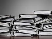 Files stacked on a desk — Stock Photo