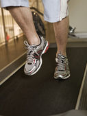 Man running on a treadmill — Stock Photo