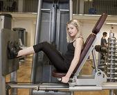 Ragazza exercing le gambe — Foto Stock